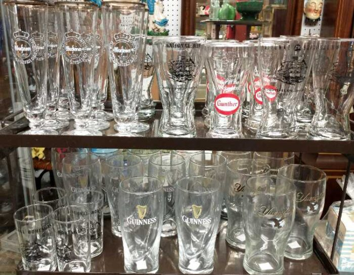 Collection of beer glasses including Gunther, Guinness, Yuengling, and more.