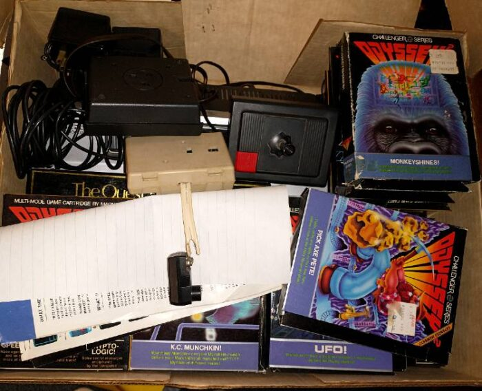 A photo of video games and controls that come with the Odysses 2 Video Game System available at Bahoukas.