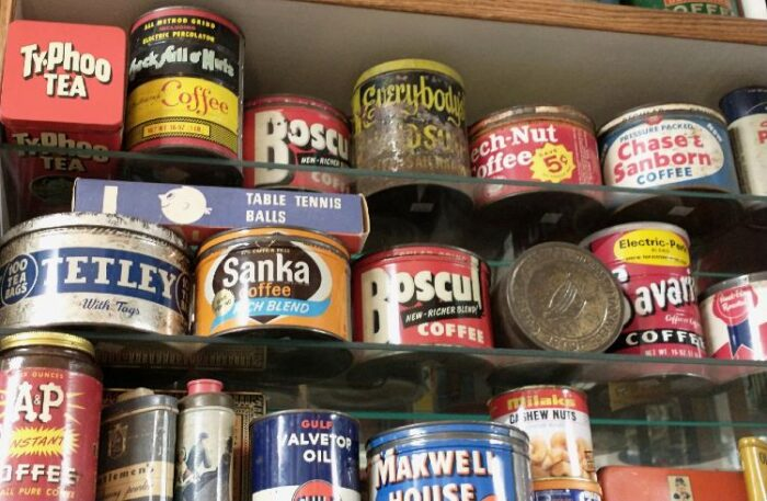 wonderful selection of tin cans available at Bahoukas Antiques - coffee, tea, nuts, toothpaste and more