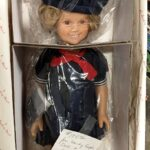 Shirley Temple doll with a variety of 16 outfits at Bahoukas