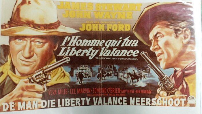 A lobby card for John Wayne and James Stewart for the movie, Who Shot Liberty Valence, in German