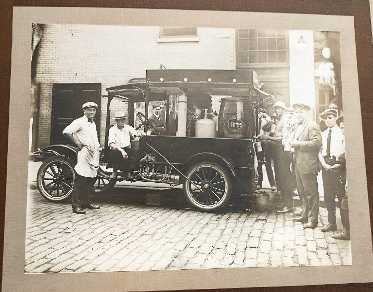vintage photo of people around an old vehicle
