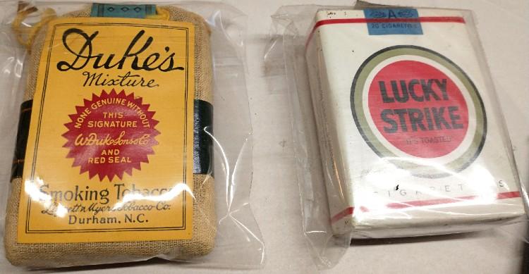 old cigarette packs of Duke's and Lucky Strikes