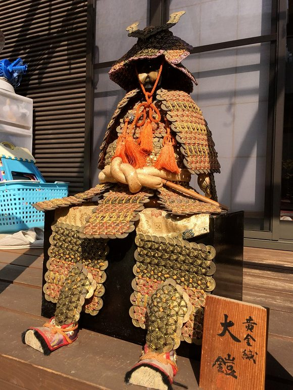 A photo of an entire suit of Samurai armor created in coin craft by a gradeschool student in Tokyo in the 1980s. From Japan Today magazine