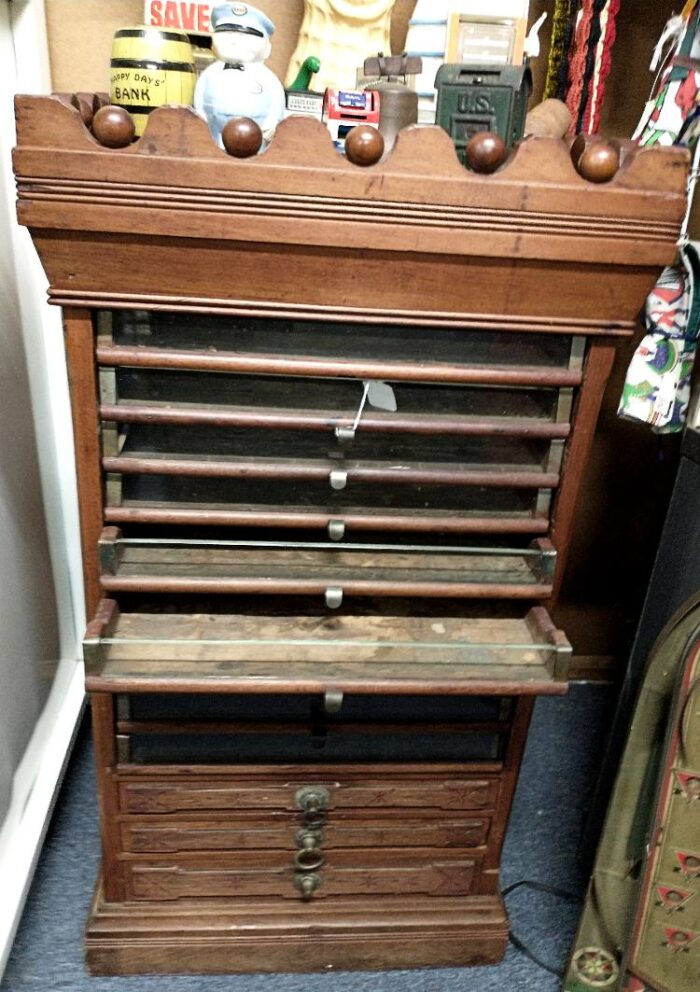 Beautiful 1800s vintage sewing thread display case at Bahoukas Antiques.